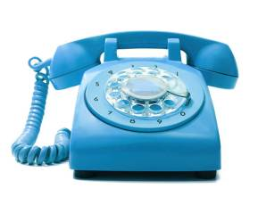 Old-fashioned blue telephone on a white background.